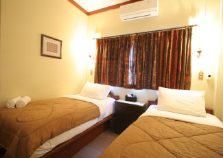 STANDARD AIR CON ROOM WITH 2 SINGLE BEDS