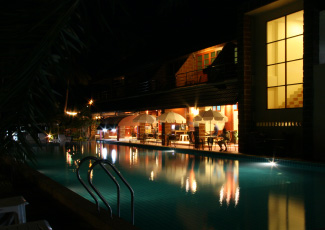 Restaurant by the swimming pool at night time